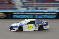 Chase Elliott (9) races through Turn 4 during the NASCAR Cup Series auto race at Phoenix Raceway, Sunday, Nov. 8, 2020, in Avondale, Ariz. (AP Photo/Ralph Freso)