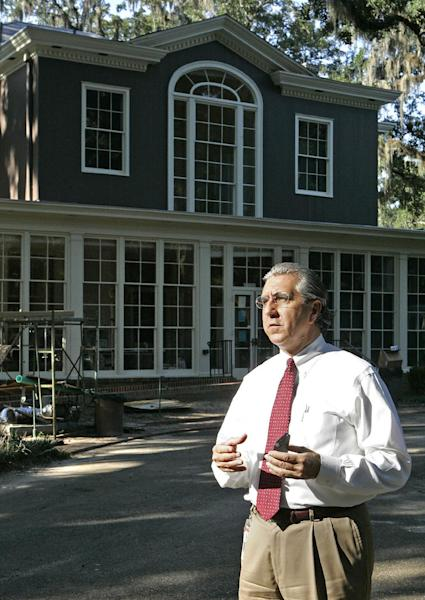 In this Aug. 29, 2013 photo, Robert Bendus, Director of Florida Division of Historical Resources, stands for a photo by the Grove, a historical mansion that once belonged to former Florida Gov. LeRoy Collins in Tallahassee, Fla. The state, at a cost of nearly $6 million, is turning the Greek Revival style mansion and its 10-acre grounds into a museum designed to document the lives of the state's governors as well as an architectural classroom for visitors. (AP Photo/Steve Cannon)