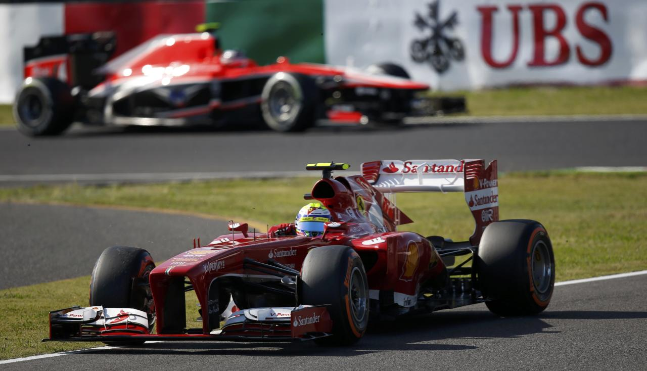 Ferrari Formula One driver Felipe Massa of Brazil drives during the qualifying session of the Japanese F1 Grand Prix at the Suzuka circuit October 12, 2013. REUTERS/Toru Hanai (JAPAN - Tags: SPORT MOTORSPORT F1)
