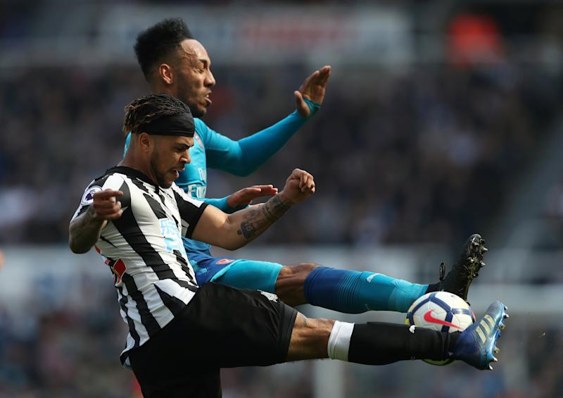 Newcastle's De Andre Yedlin battles with Arsenal's Pierre Emerick Aubameyang. More