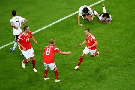 Soccer Football - World Cup - Group A - Russia vs Egypt - Saint Petersburg Stadium, Saint Petersburg, Russia - June 19, 2018 Russia's Denis Cheryshev celebrates scoring their second goal with team mates REUTERS/Michael Dalder