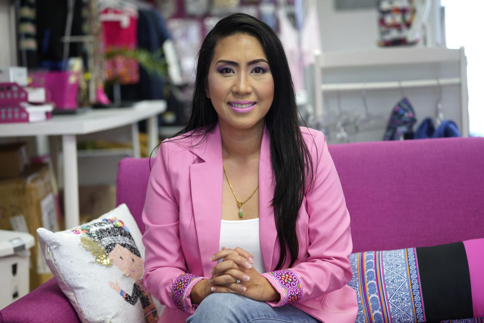 Mai Xiong, a new member of the Macomb County Board of Commissioners, sits for a portrait in her store in Warren, Mich., Thursday, April 29, 2021. In April, the board adopted her resolution condemning hate crimes and hateful rhetoric against Asian Americans. (AP Photo/Paul Sancya)