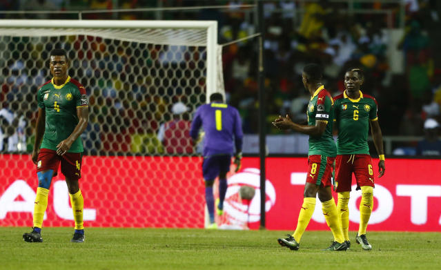 Football Soccer - African Cup of Nations - Final - Egypt v Cameroon - Stade d'Angondjé - Libreville, Gabon - 5/2/17 Cameroon's Adolphe Teikeu, Fabrice Ondoa, Benjamin Moukandjo and Ambroise Oyongo look dejected after Egypt's Mohamed Elneny scores their first goal Reuters / Amr Abdallah Dalsh Livepic