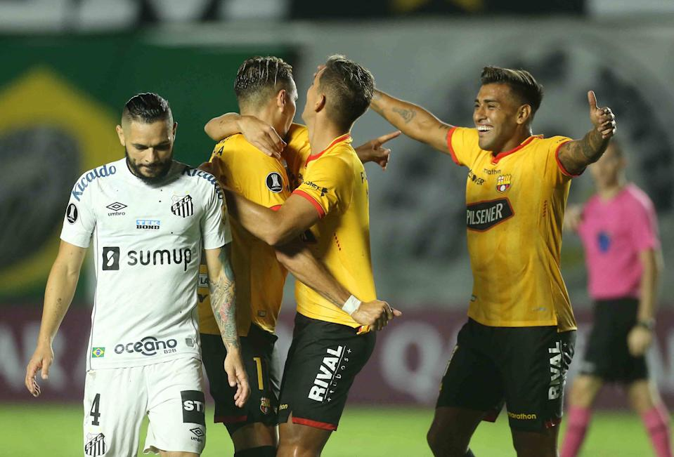 Ecuador's Barcelona Carlos Garces (L) celebrates with teammates after scoring a goal against Brazil's Santos during their Copa Libertadores football tournament group stage match at the Vila Belmiro stadium in Santos, Brazil, on April 20, 2021. (Photo by GUILHERME DIONIZIO / POOL / AFP) (Photo by GUILHERME DIONIZIO/POOL/AFP via Getty Images)