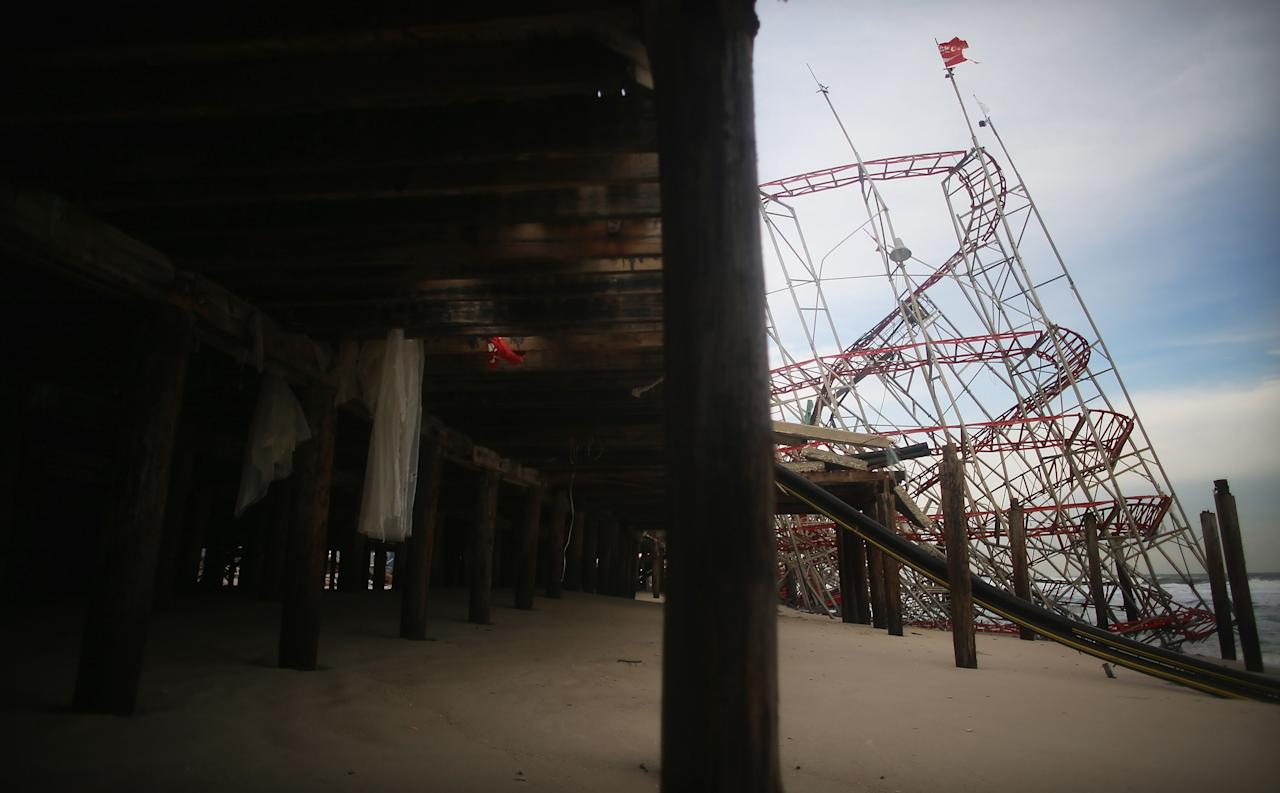 SEASIDE HEIGHTS, NJ - NOVEMBER 16: A destroyed roller coaster from the Funtown Pier sits on the beach on November 16, 2012 in Seaside Heights, New Jersey. Two amusement piers and a number of roller coasters in the seaside town were destroyed by Superstorm Sandy.   (Photo by Mario Tama/Getty Images)