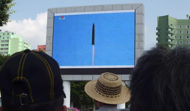 Pyongyang residents watch the successful launch of an ICBM in 2017. Photo: AFP