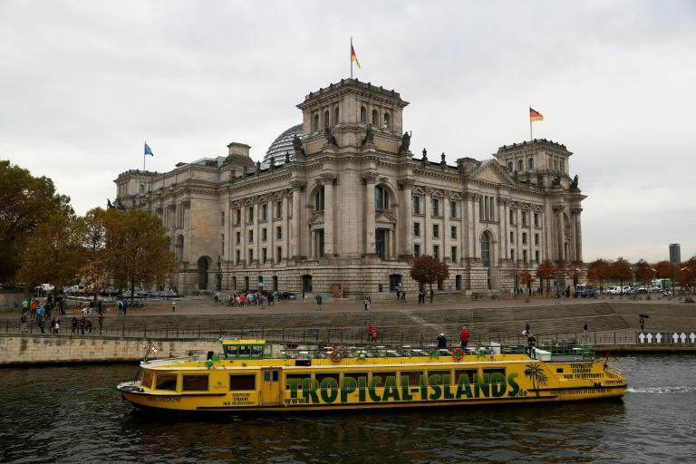 A boat with the colours of Jamaica's national flag in front of the Bundestag in Berlin