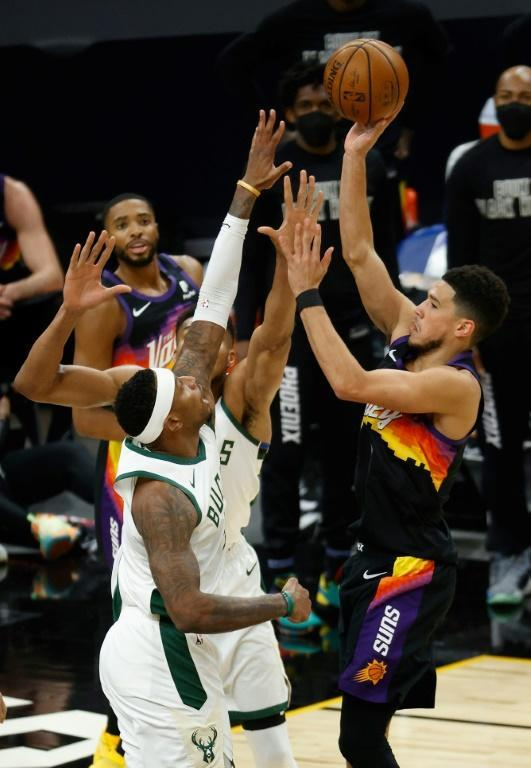 Phoenix's Devin Booker puts up a shot against the Milwaukee Bucks, the team the Suns will meet in the NBA Finals