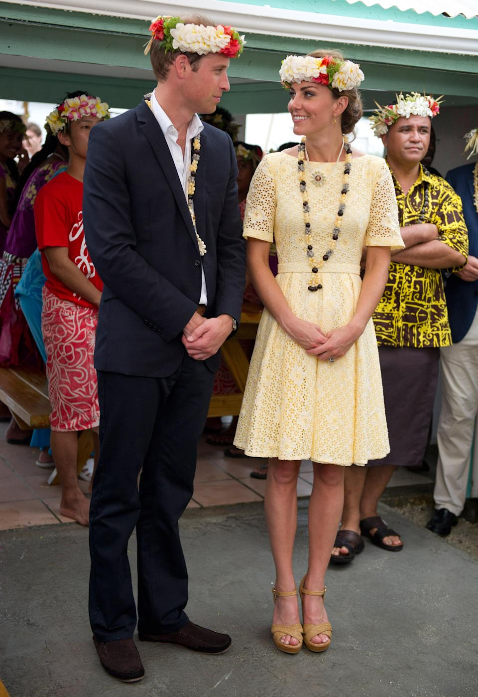 <p>The Duchess spent a day in the Solomon Islands in a primrose yellow dress featuring a broderie anglaise design. She teamed the look with Stuart Weitzman wedges. <em>[Photo: Getty]</em> </p>