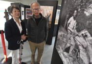 In this Friday, Oct. 1, 2021, photo principal donors, Franklin and Sandra Yee from Sacramento, Calif., tour the dedication ceremonies of the restored 1917 Chinese Laundry building at Wawona in Yosemite National Park, Calif. Officials unveiled on Friday a new sign and exhibit inside a building originally used as a laundry by Chinese workers at Yosemite's Wawona Hotel, formally recognizing Chinese Americans' contributions to the national park's history. (John Walker/The Fresno Bee via AP)