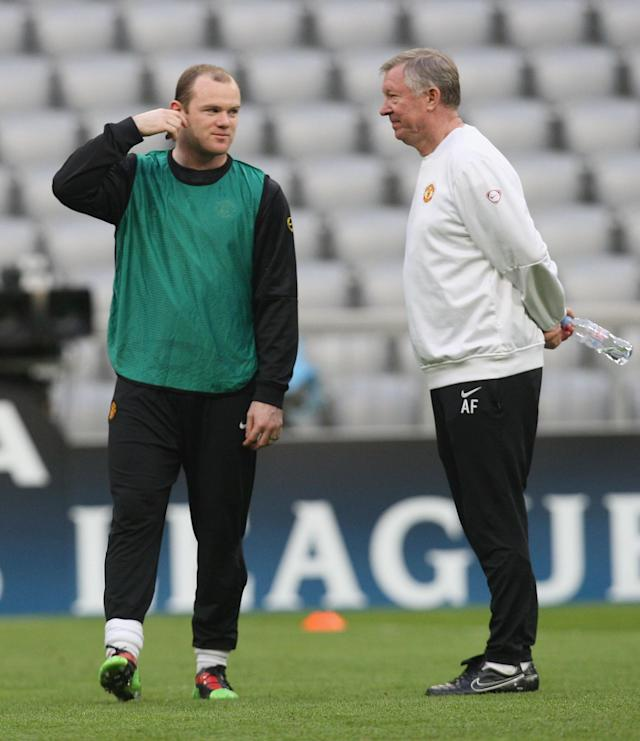 MUNICH, GERMANY - MARCH 29: Wayne Rooney and Sir Alex Ferguson of Manchester United in action during a First Team Training Session ahead of their UEFA Champions League Quarter-Final First Leg match against Bayern Munich at the Allianz Arena on March 29, 2010 in Munich, Germany. (Photo by John Peters/Manchester United via Getty Images)