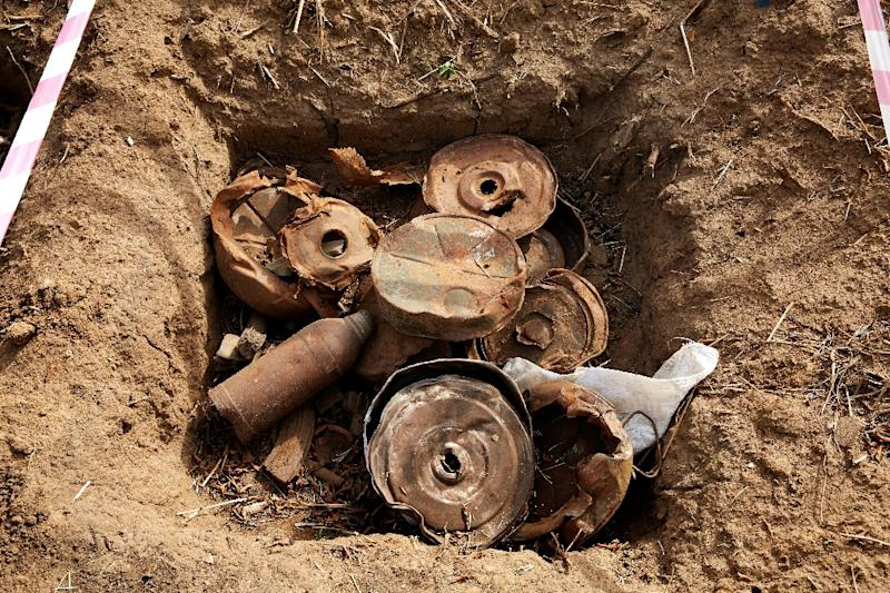 The Islamic State group planted mines and rigged buildings with explosives as they withdrew from territory they lost during fighting in Syria