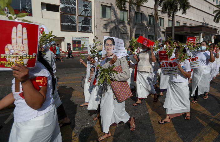 Demonstrators display placards with pictures of deposed Myanmar leader Aung San Suu Kyi and three-fingered salutes to protest against the military coup in Yangon, Myanmar Wednesday, Feb. 17, 2021. The U.N. expert on human rights in Myanmar warned of the prospect for major violence as demonstrators gather again Wednesday to protest the military's seizure of power. (AP Photo)