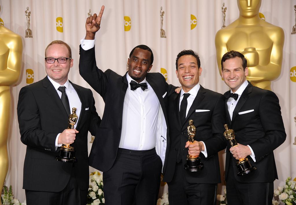 (L-R) Producers Rich Middlemas and Sean Combs, and directors T.J. Martin and Dan Lindsay pose in the press room at the 84th Annual Academy Awards held at the Hollywood & Highland Center on February 26, 2012 in Hollywood, California.