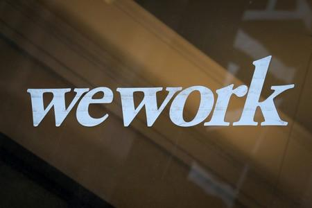 The WeWork logo is displayed on the entrance of a co-working space in New York