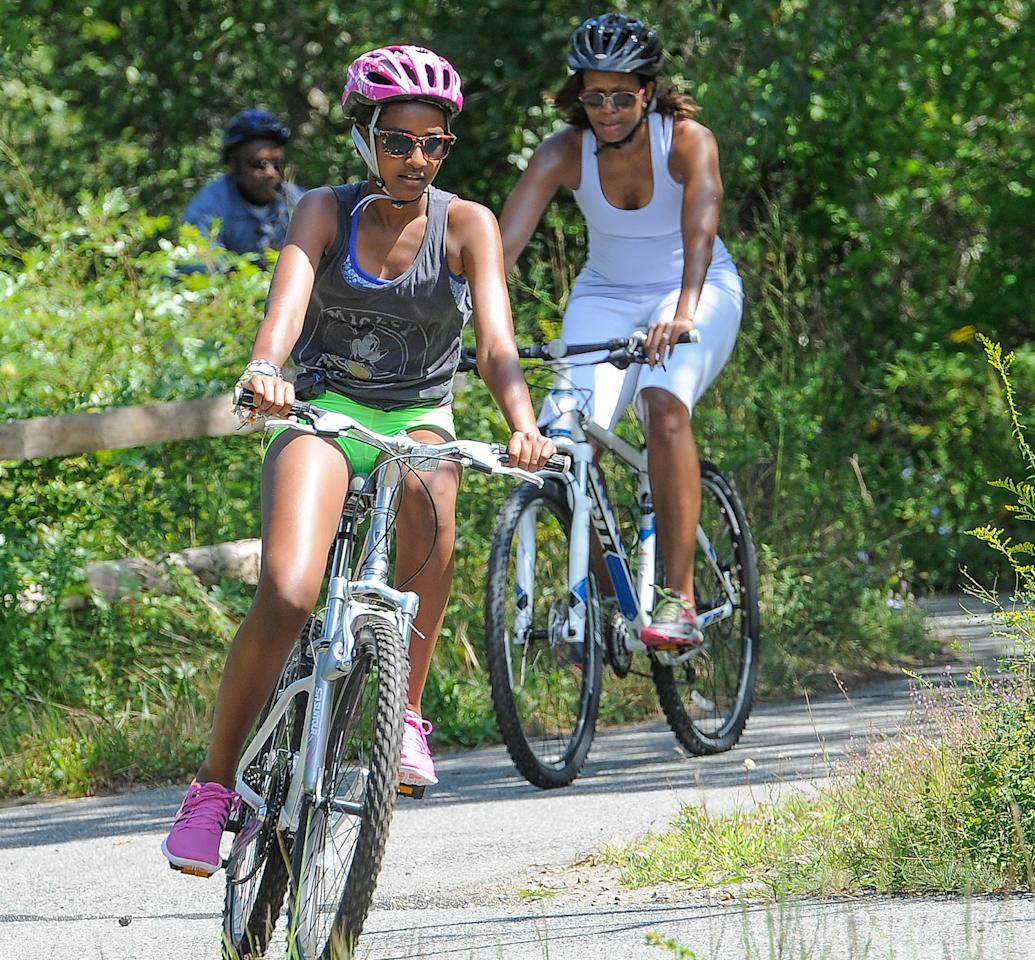 Meanwhile, first lady Michelle Obama and Sasha, 12, paired up. The younger first daughter is getting so big! (8/16/2013)
