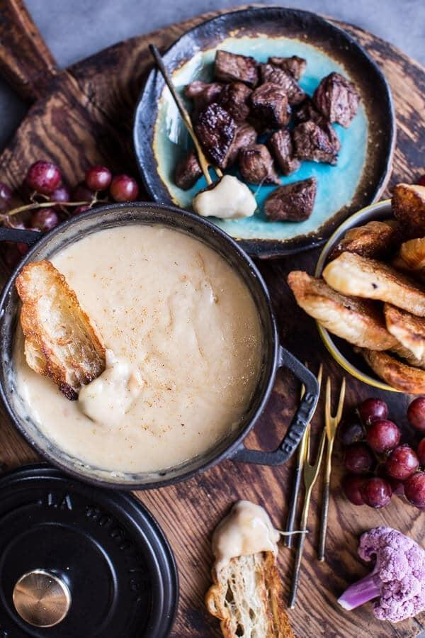 "<p>If you like cheese, you'll <em>love</em> this mouthwatering fondue. Complete with smoked gouda, gruyere, and Swiss cheese, this fondue has a rich pairing of flavors that tastes even better when eaten with croissants. Enjoy!</p> <p><strong>Get the recipe</strong>: <a href=""https://www.halfbakedharvest.com/toasted-fluffernutters-cabernet-chocolate-fondue/"" class=""link rapid-noclick-resp"" rel=""nofollow noopener"" target=""_blank"" data-ylk=""slk:smoky three-cheese fondue with toasted garlic buttered croissants"">smoky three-cheese fondue with toasted garlic buttered croissants</a></p>"