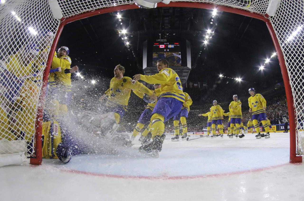 Ice Hockey - 2017 IIHF World Championship - Gold medal game - Canada v Sweden - Cologne, Germany - 21/5/17 - Players of Sweden celebrate their victory. REUTERS/Andre Ringuette/HHOF-IIHF Images/Pool