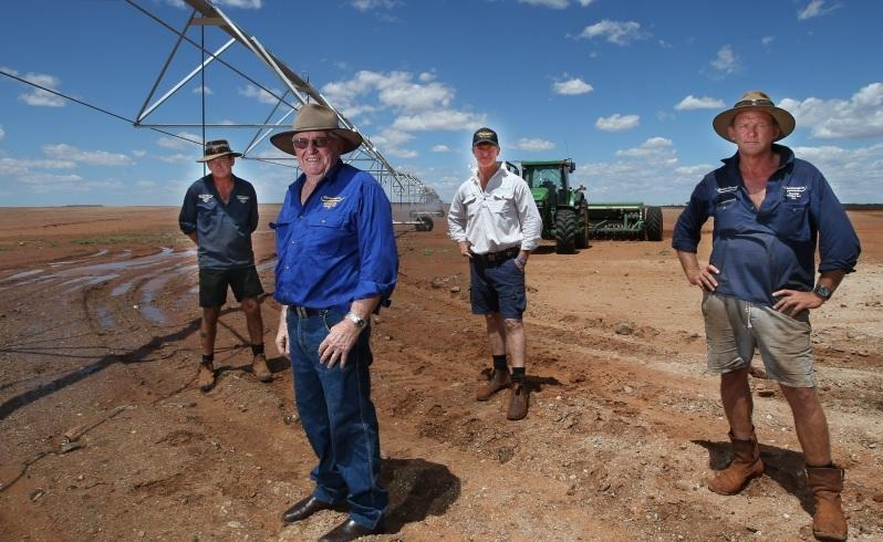 Andrew Summers, Robin Mills, Scott Mills and Nicholas Thurston with an irrigation centre pivot at Warrawagine Station. Picture: Sharon Smith/The West Australian