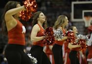 Wisconsin cheerleaders perform during the first half of a second-round game in the NCAA college basketball tournament Thursday, March 20, 2014, in Milwaukee. (AP Photo/Morry Gash)