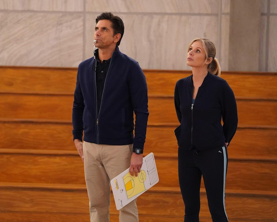 "Actors John Stamos and Jessalyn Gilsig in a scene from the new Disney+ series ""Big Shot."""