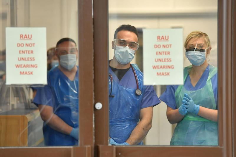A file photo of doctors wearing personal protective equipment at a hospital: PA