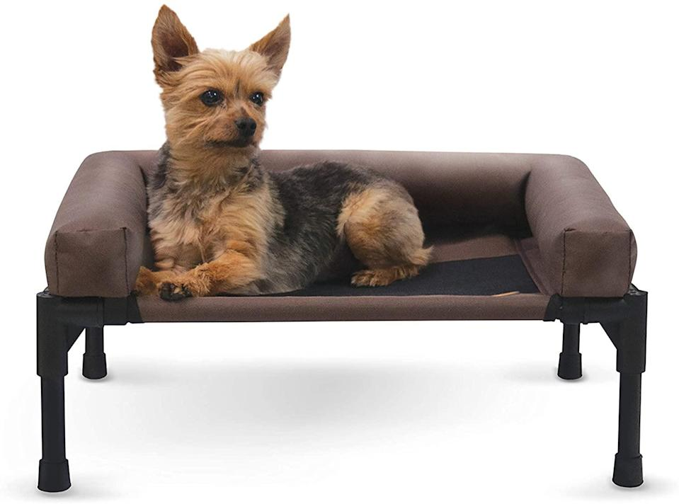 """<p>Put your pet on a pedastal with this raised bed that helps furry friends stay cool and comfortable. </p> <p><strong>Buy it!</strong> Original Bolster Pet Cot Elevated Pet Bed, Starts at $32.99; <a href=""""https://www.amazon.com/Pet-Products-Original-Elevated-Chocolate/dp/B06XGYRFGB/"""" rel=""""nofollow noopener"""" target=""""_blank"""" data-ylk=""""slk:Amazon.com"""" class=""""link rapid-noclick-resp"""">Amazon.com</a></p>"""