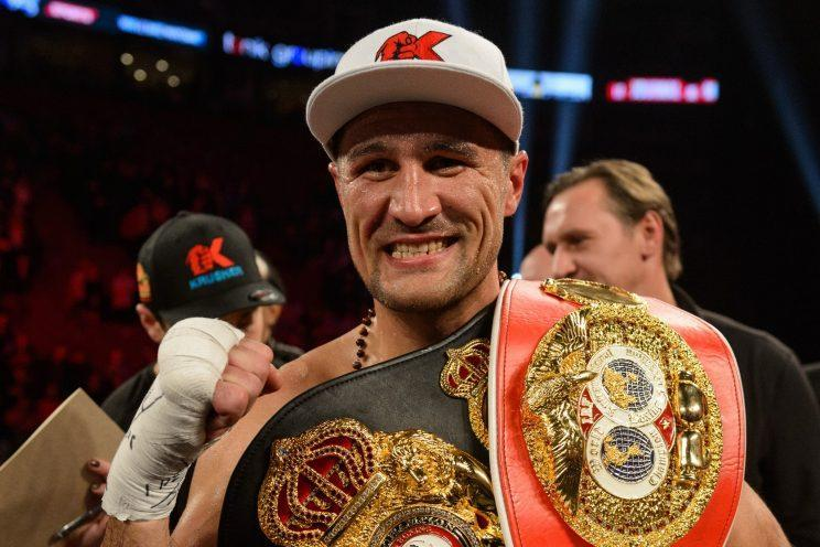 Sergey Kovalev poses with his belts after defeating Jean Pascal. (Getty Images)