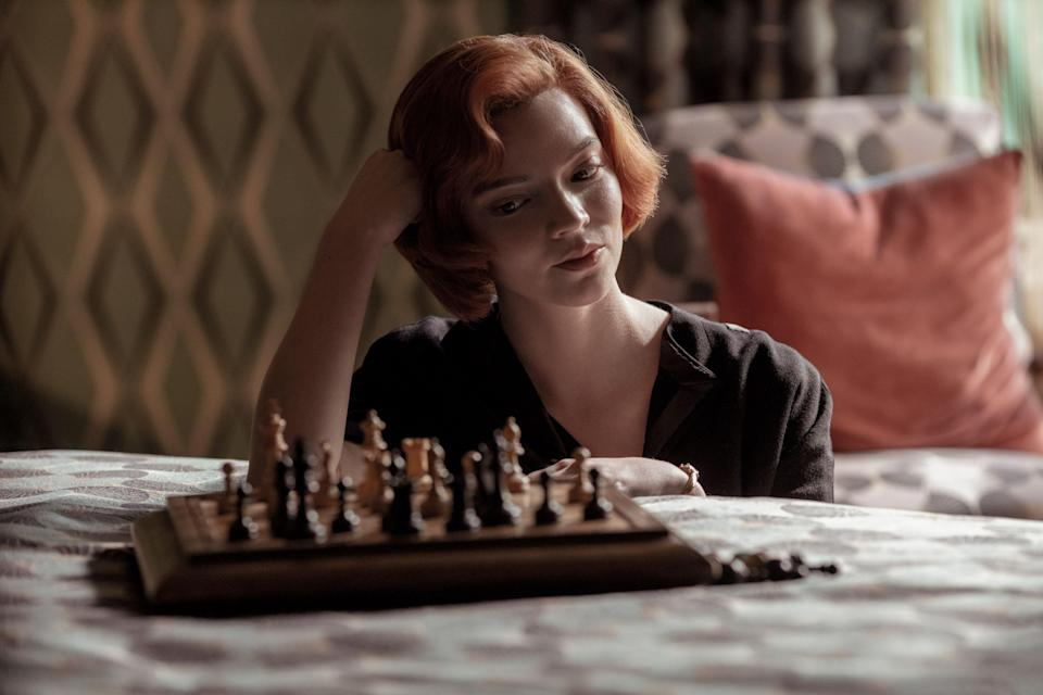 """<p>A show about an orphaned chess prodigy who spends her high school years and early twenties on a relentless quest to become the best player in the world may not sound like particularly thrilling TV, but trust us—you won't be able to look away from <em><a href=""""https://www.marieclaire.com/culture/a34483986/the-queens-gambit-true-story-beth-harmon/"""" rel=""""nofollow noopener"""" target=""""_blank"""" data-ylk=""""slk:The Queen's Gambit"""" class=""""link rapid-noclick-resp"""">The Queen's Gambit</a></em>. The Netflix miniseries is part inspirational tale of a young girl's unflagging ambition, part gritty drama about her struggle with <a href=""""https://www.marieclaire.com/culture/a34496439/the-queens-gambit-green-pills/"""" rel=""""nofollow noopener"""" target=""""_blank"""" data-ylk=""""slk:substance abuse"""" class=""""link rapid-noclick-resp"""">substance abuse</a>, and part <a href=""""https://www.marieclaire.com/beauty/a34484644/the-queens-gambit-beauty/"""" rel=""""nofollow noopener"""" target=""""_blank"""" data-ylk=""""slk:sexy 1960s period piece"""" class=""""link rapid-noclick-resp"""">sexy 1960s period piece</a>. It's an adaptation of the 1983 novel of the same name by Walter Tevis, and after nearly four decades in development hell—during which, at one point, Heath Ledger was attached to direct and star—the 2020 version of <em>The Queen's Gambit</em> was helmed and created by Scott Frank, and stars an ensemble cast of ultra-recognizable stars who will have you wondering where, exactly, you've seen them before. Instead of scrambling down a Wikipedia black hole, click through to unravel the mystery of who's who in the cast of <em>The Queen's Gambit</em>.</p>"""