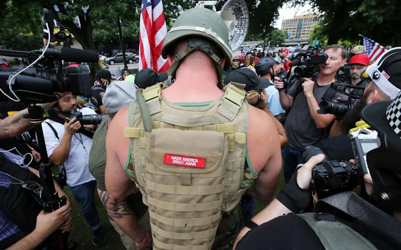 Police have been attempting to separate the two groups - Getty Images North America