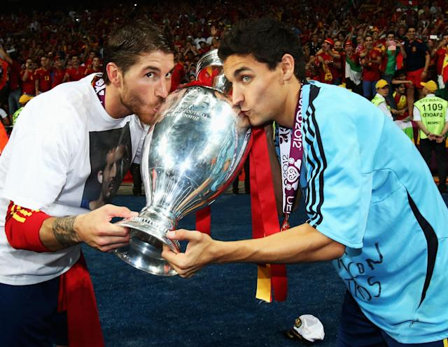 KIEV, UKRAINE - JULY 01: Sergio Ramos and Jesus Navas of Spain kiss the trophy following victory in the UEFA EURO 2012 final match between Spain and Italy at the Olympic Stadium on July 1, 2012 in Kiev, Ukraine. (Photo by Alex Grimm/Getty Images)