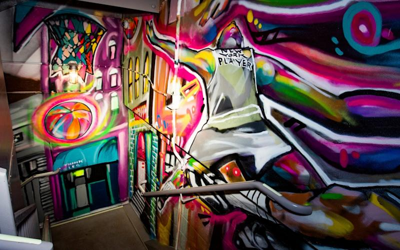 Art in a hotel in Bowery, New York, by one of the artists whose work was lost at 5Pointz - Christian Johnson/AP