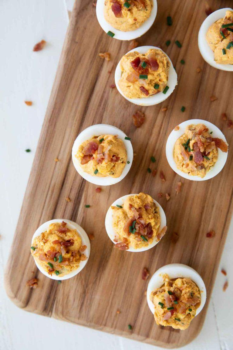"<p>Bacon, paprika, and hot sauce give a bold taste to these delicious deviled eggs.</p><p><strong>Get the recipe at <a href=""https://www.tasteandtellblog.com/bacon-and-deviled-eggs/"" rel=""nofollow noopener"" target=""_blank"" data-ylk=""slk:Taste and Tell"" class=""link rapid-noclick-resp"">Taste and Tell</a>.</strong></p><p><strong><a class=""link rapid-noclick-resp"" href=""https://www.amazon.com/Anchor-Hocking-Company-86148-Presence/dp/B000W4EGXG/?tag=syn-yahoo-20&ascsubtag=%5Bartid%7C10050.g.2966%5Bsrc%7Cyahoo-us"" rel=""nofollow noopener"" target=""_blank"" data-ylk=""slk:SHOP DEVILED EGG TRAYS"">SHOP DEVILED EGG TRAYS</a><br></strong></p>"