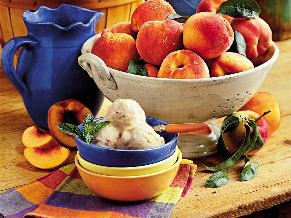 """<p>Cool off this summer with a refreshing scoop (or a few) of our homemade peach <a href=""""https://www.myrecipes.com/summer-grilling/desserts/homemade-ice-cream-recipes"""" rel=""""nofollow noopener"""" target=""""_blank"""" data-ylk=""""slk:ice cream"""" class=""""link rapid-noclick-resp"""">ice cream</a>. Offering the classic peaches-and-cream combo in every bite, this fruit-based ice cream is the perfect way to showcase bright summer flavors. If you're able to use fresh Georgia peaches, you're one of the lucky ones. Make a batch while <a href=""""https://www.myrecipes.com/ingredients/fruit-recipes/our-best-peach-recipes"""" rel=""""nofollow noopener"""" target=""""_blank"""" data-ylk=""""slk:peaches are in season"""" class=""""link rapid-noclick-resp"""">peaches are in season</a>, and enjoy the silky-smooth treat all summer long. Pair it with a fresh slice of peach pie, a toasted pecan topping, or just a warm evening outdoors. This delightfully creamy dessert is sure to become a summertime favorite.</p>"""