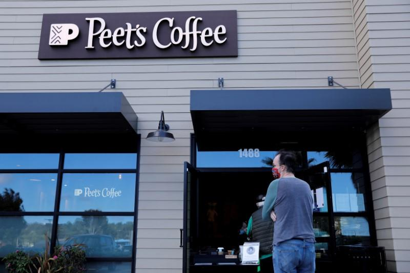FILE PHOTO: Customers wear masks as they wait in line at a Peet's coffee shop in Encinitas, California