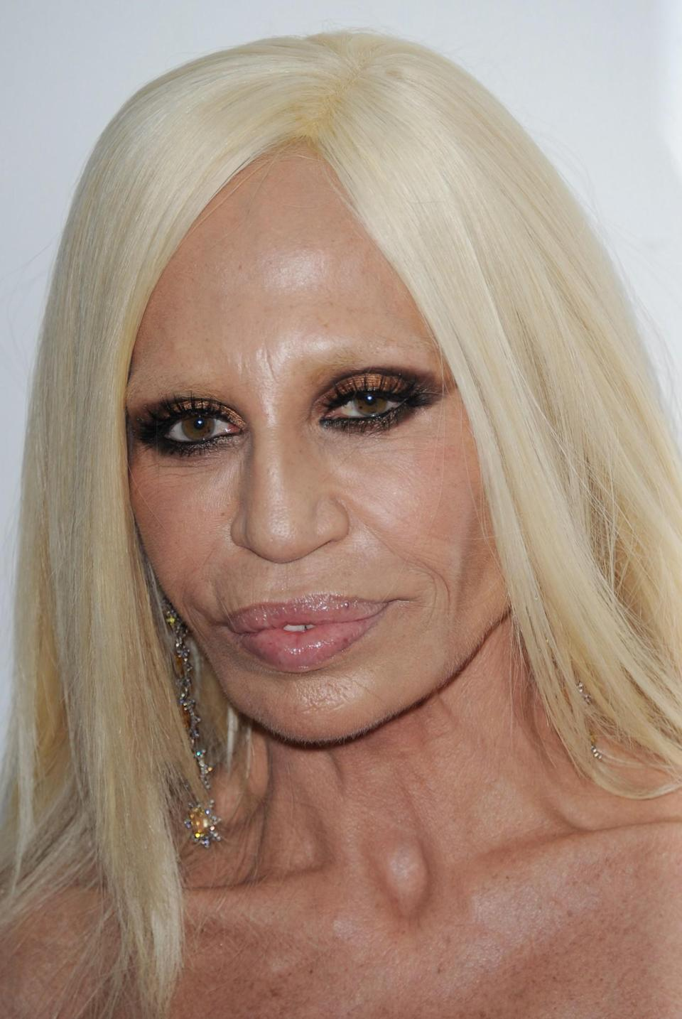 <p>In recent years, Donatella has appeared line-free with some likening her to a waxwork. <i>[Photo: Getty]</i> </p>
