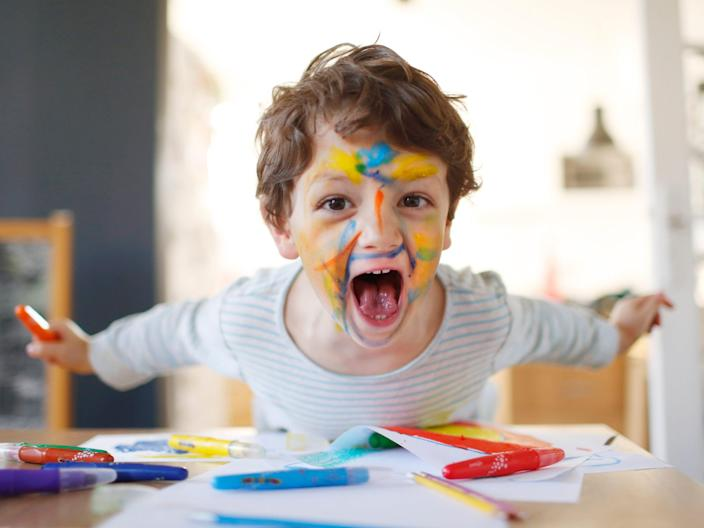 child with marker on face