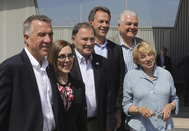 From left to right, Vermont Gov. Phil Scott, Oregon Gov. Kate Brown, Utah Gov. Gary Herbert, Montana Gov. Steve Bullock, Nevada Gov. Steve Sisolak and Maine Gov. Janet Mills pose for a photograph following a news conference launching an Outdoors Recreation Initiative Wednesday, July 24, 2019, in Salt Lake City. Governors from about 25 states are gathering in Utah this week for the summer conference of the National Governors Association. The state leaders are expected to discuss infrastructure, cybersecurity and health care at the three-day conference in Salt Lake City that runs Wednesday through Friday. (AP Photo/Rick Bowmer)