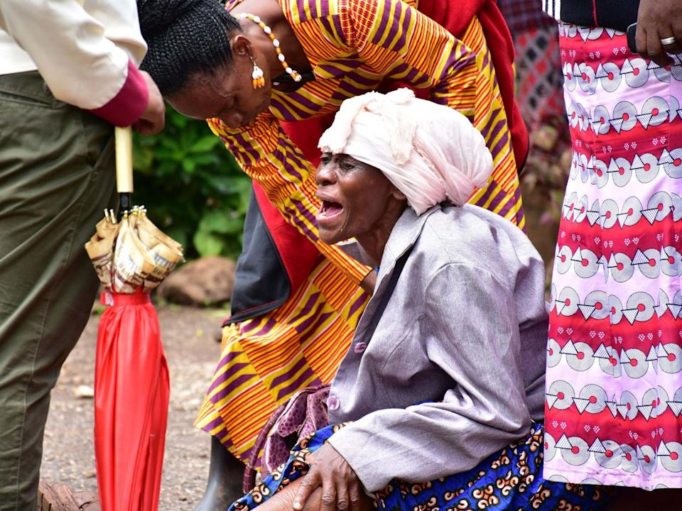 Moshi residents in Kilimanjaro region grieve at Mawenzi hospital after the death of her granddaughter who was killed in stampede: AFP via Getty Images