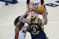 Indiana Pacers forward Domantas Sabonis (11) shoots infront of Miami Heat forward Precious Achiuwa (5) during the first half of an NBA basketball game in Indianapolis, Wednesday, March 31, 2021. (AP Photo/AJ Mast)