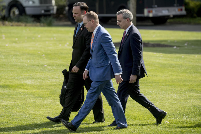 From left, White House Social Media Director Dan Scavino, President Donald Trump's Chief of Staff Mick Mulvaney, and White House Counsel Pat Cipollone, walk across the South lawn to board Marine One on the South Lawn of the White House, Thursday, April 18, 2019, to travel with President Donald Trump for a short trip to Andrews Air Force Base, Md. President Trump is traveling to his Mar-a-lago estate to spend the Easter weekend in Palm Beach, Fla.  (AP Photo/Andrew Harnik)