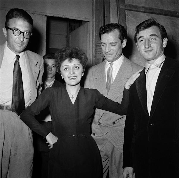 Aznavour, right, got his big break when he opened for the rising French star Edith Piaf, second-from-left (AFP Photo/-)