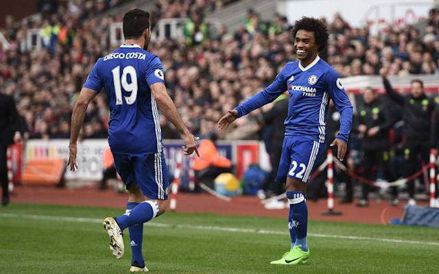 <span>Willian (R) is congratulated after his goal</span>