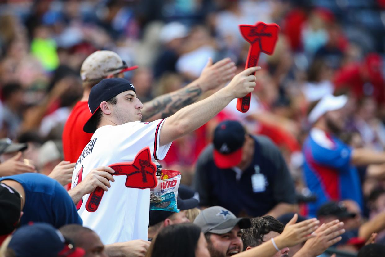"""ATLANTA, GA - AUGUST 20:  Atlanta Braves fans doing the """"Tomahawk Chop"""" during the game against the Washington Nationals at Turner Field on August 20, 2016 in Atlanta, Georgia. (Photo by Kevin Liles/Getty Images)"""