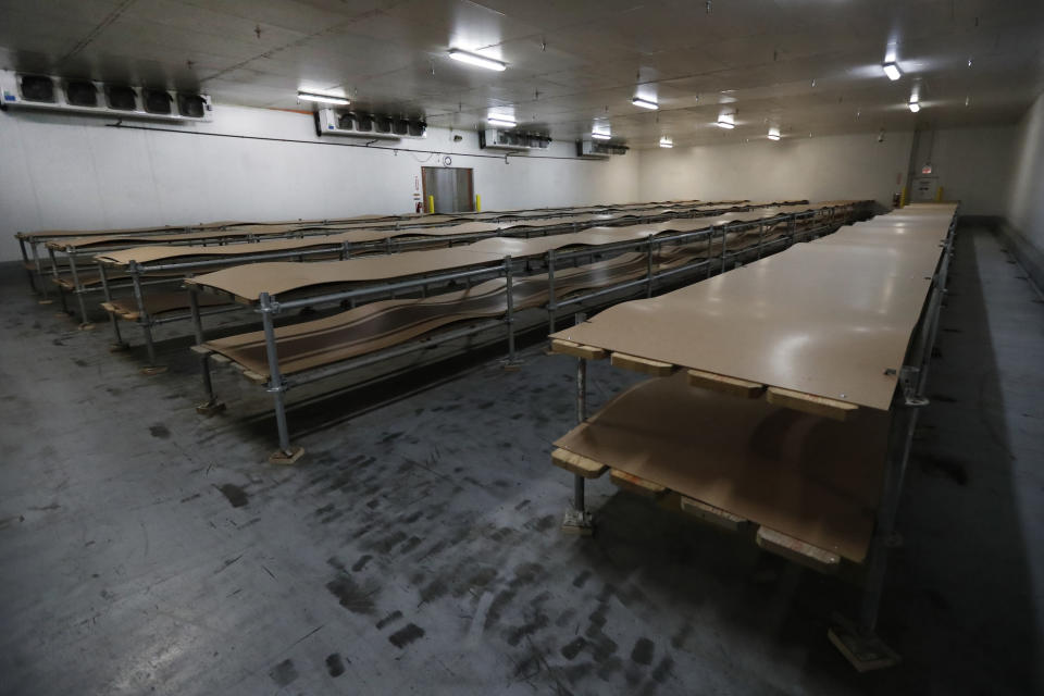 This Tuesday, May 5, 2020, photo, shows one of two rooms at the Cook County Medical Examiner's auxiliary storage facility that has yet to be utilized in Chicago. It is an encouraging indication the medical examiner's system to ensure most bodies are released to funeral homes as quickly as possible is working. The center has the total capacity to hold 2,000 bodies. (AP Photo/Charles Rex Arbogast)