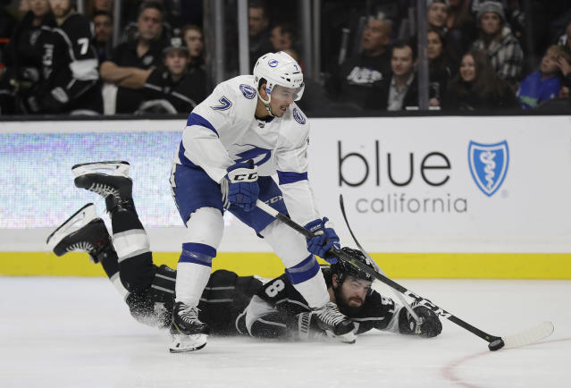 Tampa Bay Lightning's Mathieu Joseph (7) skates past Los Angeles Kings' Drew Doughty on his way to scoring a goal during the third period of an NHL hockey game Thursday, Jan. 3, 2019, in Los Angeles. (AP Photo/Marcio Jose Sanchez)