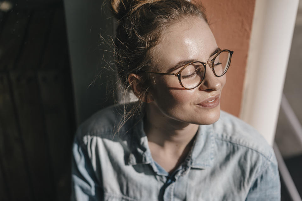 Young woman with glasses in sunlight