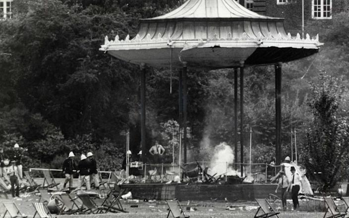 London IRA Bombing: Police and firemen at the still smouldering bandstand in Regent's Park following the bomb outrage known to have killed six people.The bomb exploded where the band of the Royal Green jackets was playing on 20 July 1982 - PA