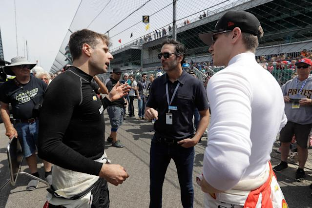 "<a class=""link rapid-noclick-resp"" href=""/nascar/sprint/drivers/213/"" data-ylk=""slk:Jimmie Johnson"">Jimmie Johnson</a> (middle) chats with Will Power (L) and Josef Newgarden at Indianapolis on Thursday. (AP Photo/Darron Cummings)"