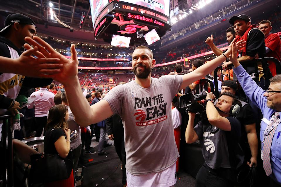 TORONTO, ONTARIO - MAY 25: Marc Gasol #33 of the Toronto Raptors high fives fans as he walks off the court after defeating the Milwaukee Bucks 100-94 in game six of the NBA Eastern Conference Finals to advance to the 2019 NBA Finals at Scotiabank Arena on May 25, 2019 in Toronto, Canada. NOTE TO USER: User expressly acknowledges and agrees that, by downloading and or using this photograph, User is consenting to the terms and conditions of the Getty Images License Agreement. (Photo by Gregory Shamus/Getty Images)